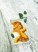 Goat's cheese fritters with olive oil foam and peaches
