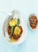 Courgette flowers stuffed with stockfish puree on tomato sauce