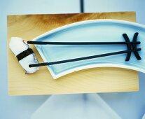 Chopstick tongs with sushi