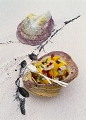 Bass with mango and pomegrante seed in mussel shells