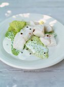 Snapper with savoy, coriander and creamy sauce