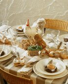 A festively laid Easter table with a chicken ornament