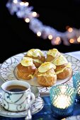 Profiteroles with white chocolate and a cup of coffee