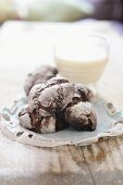 Chocolate crinkle cakes and glass of milk