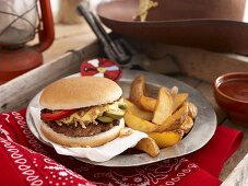 A hamburger with potato wedges for a party