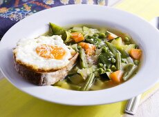 Minestrone with bread and fried egg