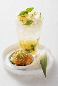 A pineapple drink with a scallop