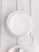 White plates on a wooden surface