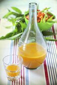 Sea buckthorn juice in a bottle and a glass