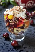 Fruit salad topped with cream