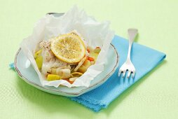 Cod with vegetables baked in parchment paper