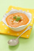 Cream of carrot soup with slivered almonds