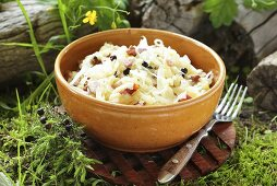 Steamed white cabbage with bacon and juniper berries and fresh herbs