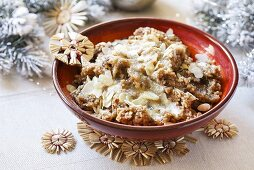 Christmas rice pudding with dried fruit and slivered almonds