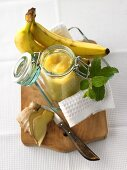Banana and ginger jam with ingredients on chopping board