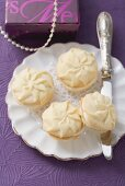 Piped biscuits with lemon cream filling for Christmas