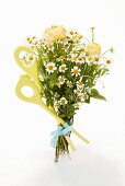 Bunch of spring flowers with kitchen spoons