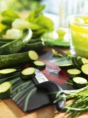 Kitchen scene with partly sliced courgettes