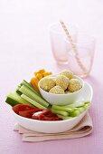 Raw vegetable sticks with cream cheese balls