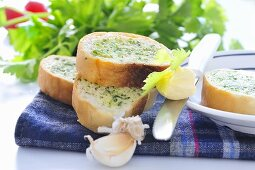 Baguette slices with herb butter and garlic