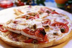 Tomato and mozzarella pizza with olives
