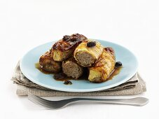 Baked stuffed cabbage leaves with raisin sauce