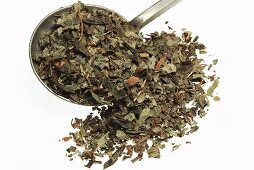 Dried asarabacca leaves (Asarum europaeum) in measuring spoon