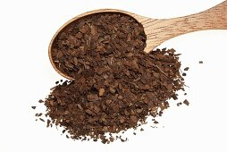 Roasted mate tea with wooden spoon
