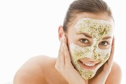 Young woman with herbal facial mask