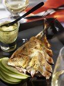 Grilled mackerel on apple slices