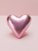 Pink heart-shaped chocolate