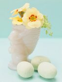Primroses in Easter vase, eggs