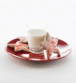 Star-shaped biscuits with a glass of milk