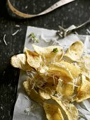 Potato crisps with Asiago cheese and thyme