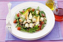 Dandelion salad with egg, tomato and croutons