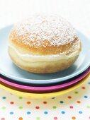 Carnival doughnut on pile of plates