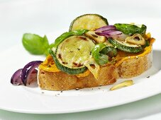 Open sandwich topped with fried courgette slices