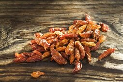 Dried chillies on wooden board