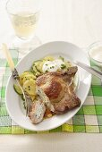 Stuffed pork chop with potato and cucumber salad