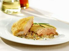 Baked salmon fillet with chanterelle sauce