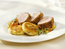 Breaded pork fillet with potato cakes