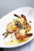 Scampi and pineapple skewers with ramsons (wild garlic)