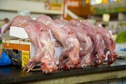 Skinned rabbits on a market stall