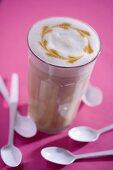 A glass of cafe latte with pattern in milk foam