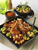 Chicken pieces with chorizo and beans