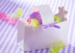 Easter egg and Easter Bunny biscuit in paper basket
