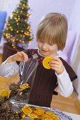Little girl making Christmas pot-pourri