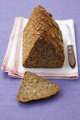 Triangular loaf of wholemeal bread with oats & sunflower seeds