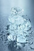 Several ice cubes on wet surface