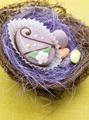 Petit four and sugar eggs in an Easter nest